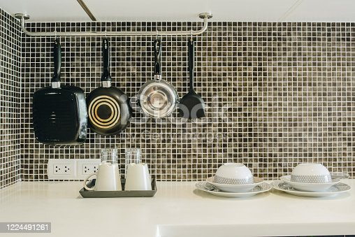 839034546 istock photo Group of kitchenware arrangement at the corner of the kitchen in hotel suite room. 1224491261