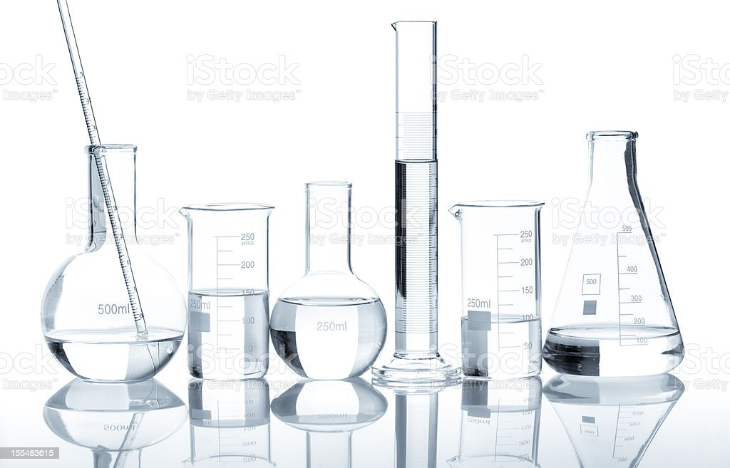 Group of laboratory flasks with a clear liquid stock photo