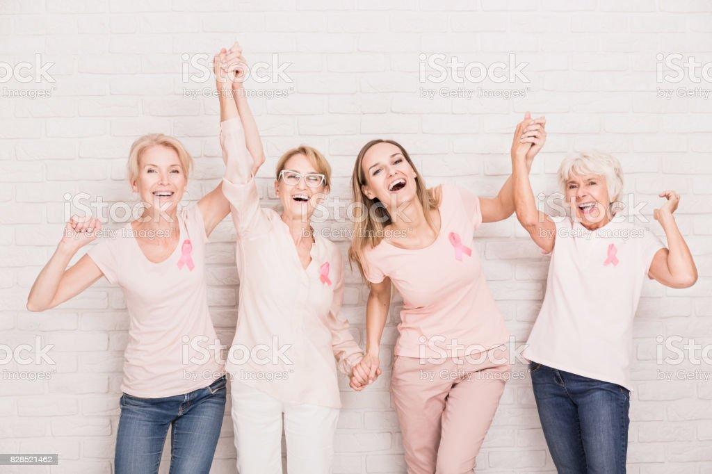 Group of ladies cheering stock photo