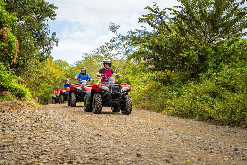 Group of latin tourists driving a 4x4 bike in Costa Rica