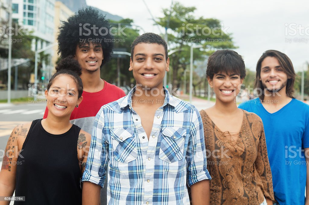 Group of laughing young adult people outdoor in city - foto de acervo