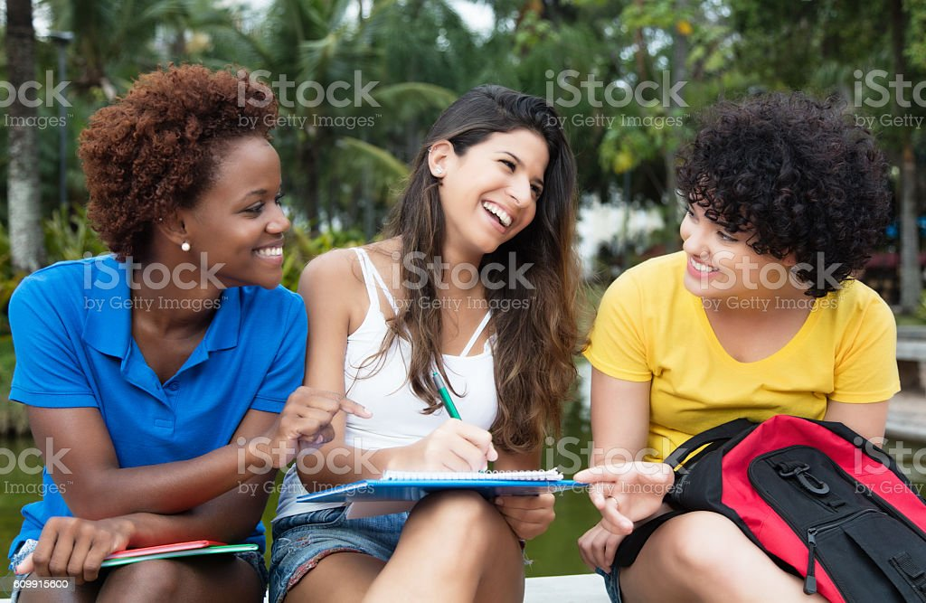 Group of learning multicultural female student - fotografia de stock