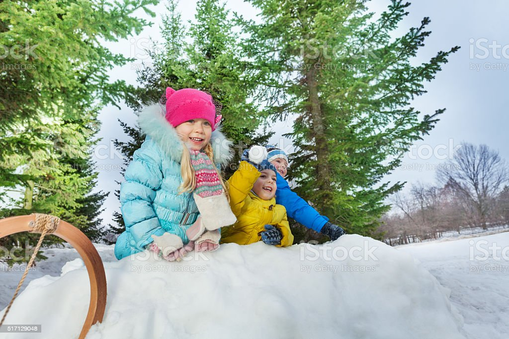 Group of little children play snowball in fortress stock photo