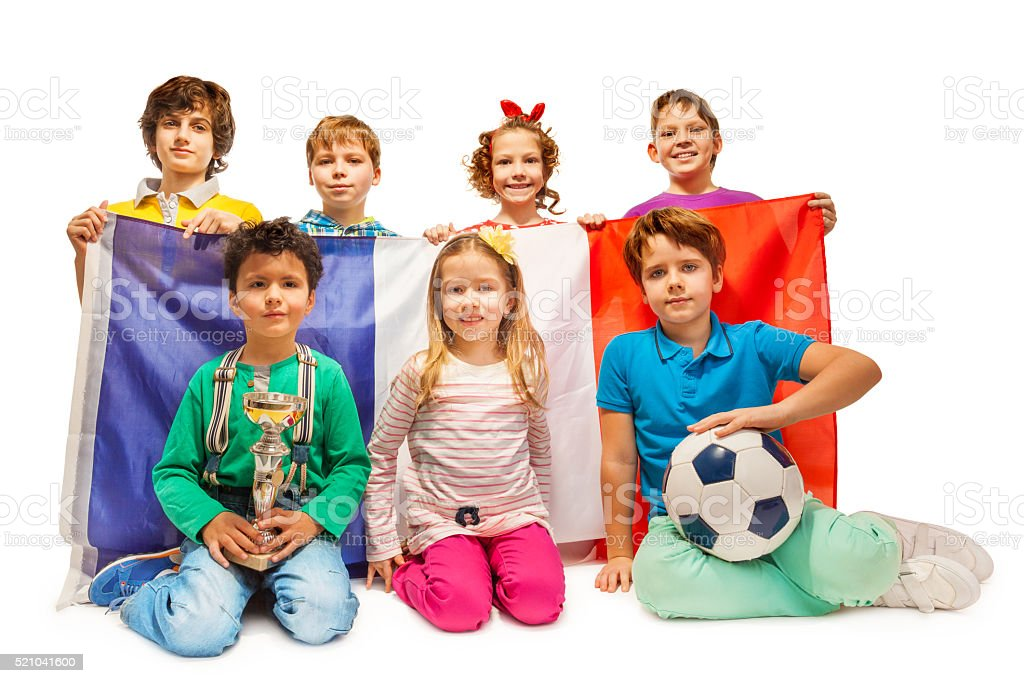 Group of little football fans holding French flag stock photo