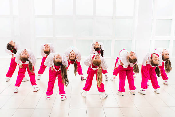 group of little girls dancing. - dance group stock photos and pictures