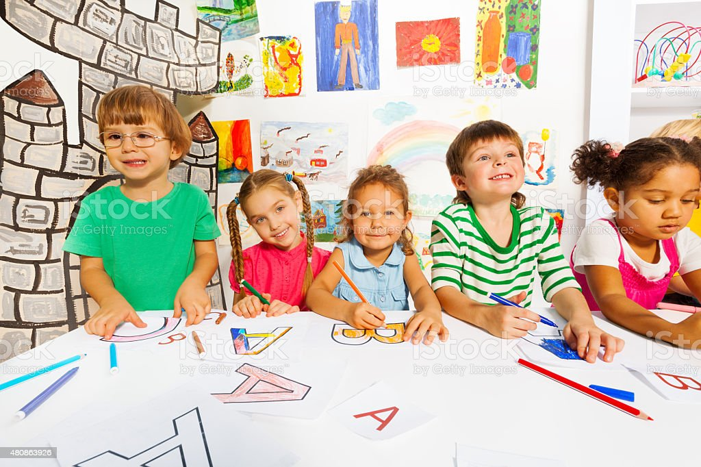 Group of little kids in early development class stock photo