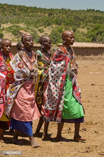 Maasai Mara, Kenya | October 18, 2007: A group of Maasai women in traditional dress performing a traditional dance