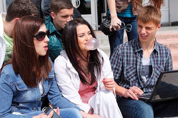 Group of male and female students stock photo