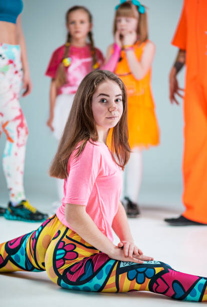 group of man, woman and teens dancing hip hop choreography - dance group stock photos and pictures