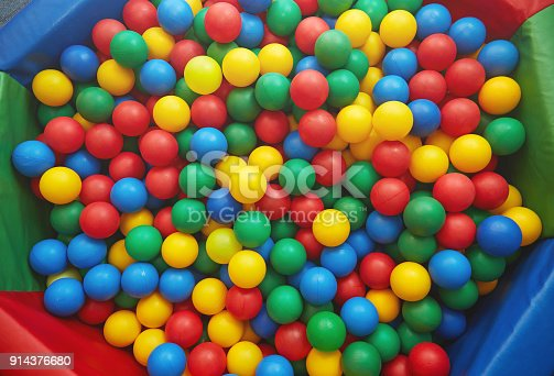 istock Group of many multicolored plastic balls. Close-up view 914376680