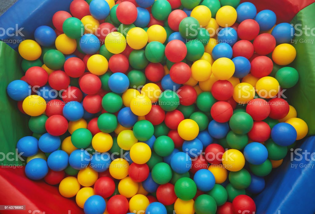 Group of many multicolored plastic balls. Close-up view stock photo