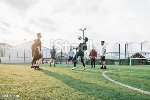 istock A group of mates playing keepy-uppy 954142718