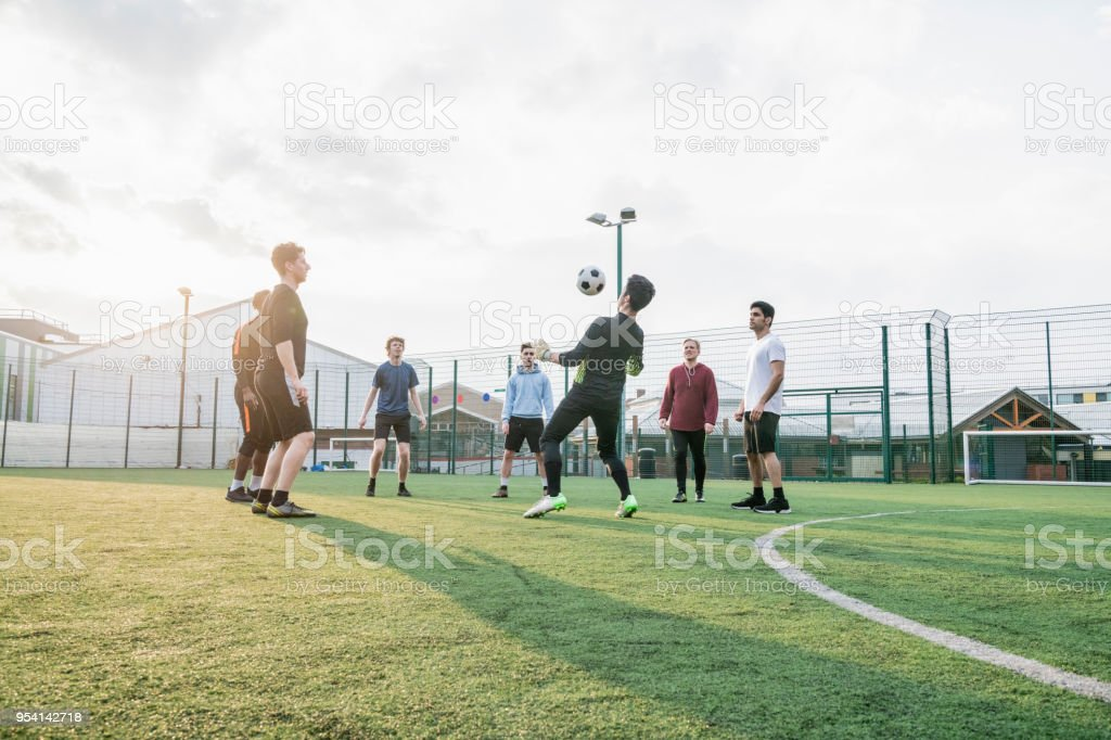 A group of mates playing keepy-uppy stock photo