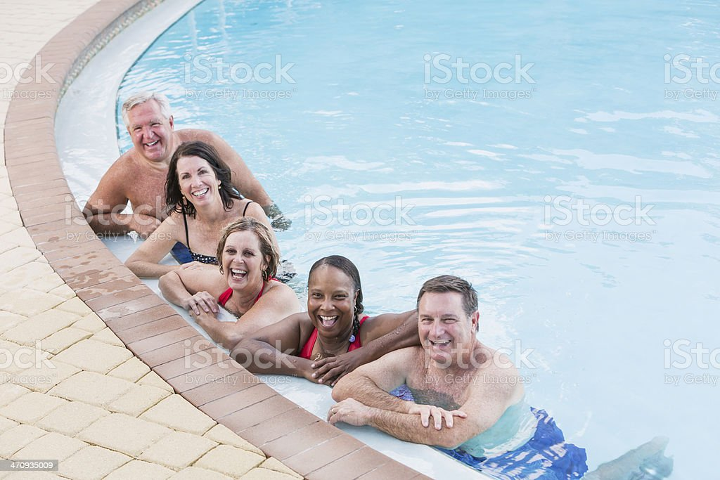 Group of mature adults in swimming pool stock photo