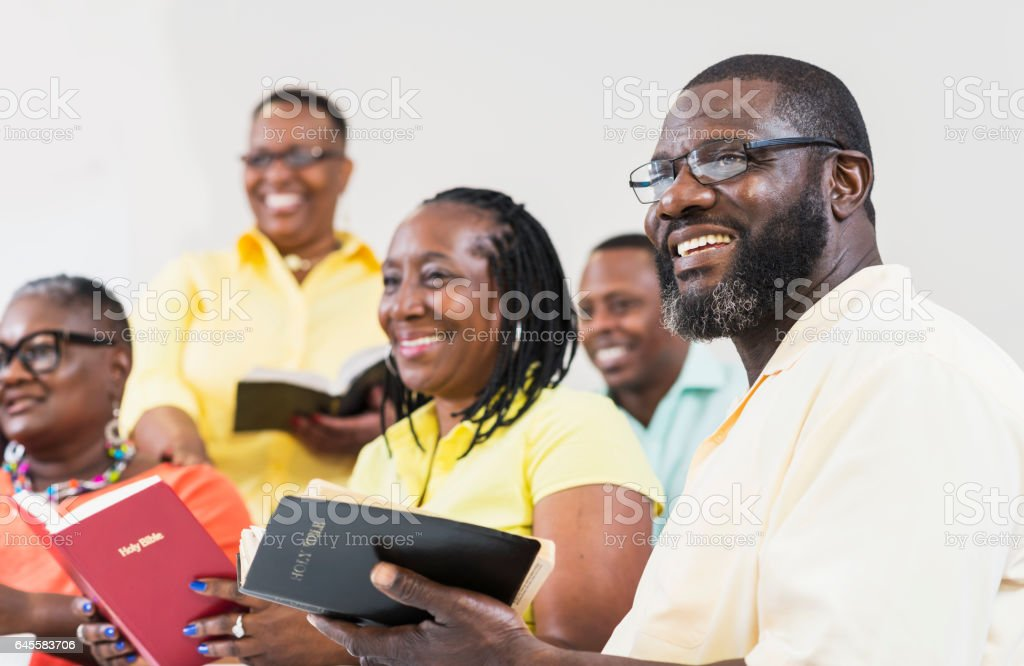 Group of mature black men and women holding bibles stock photo