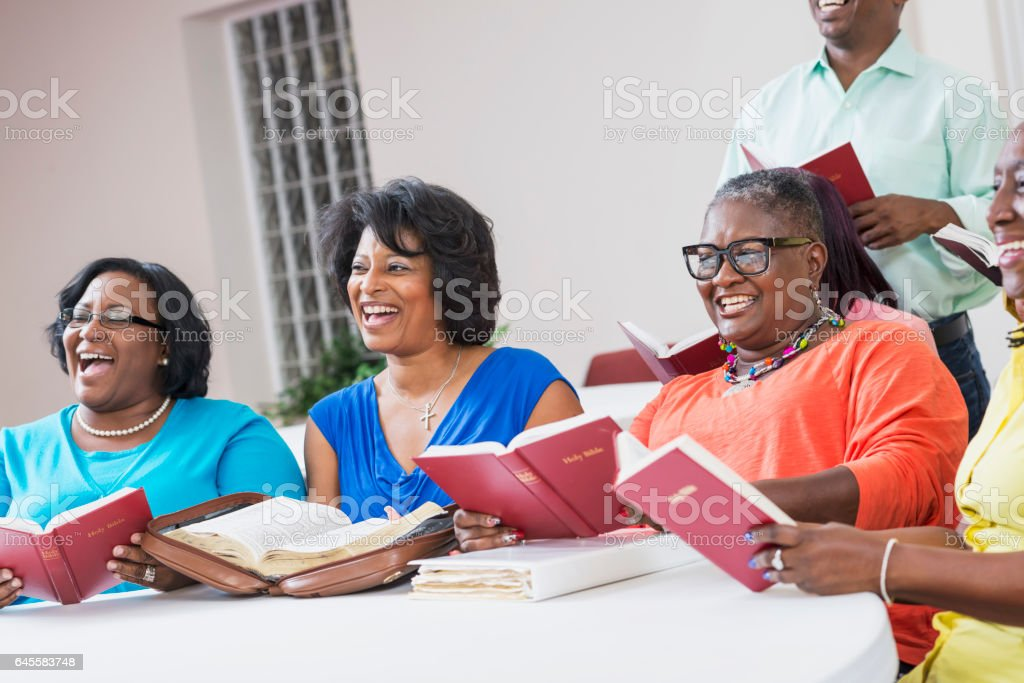 Group of mature black women in bible study meeting stock photo