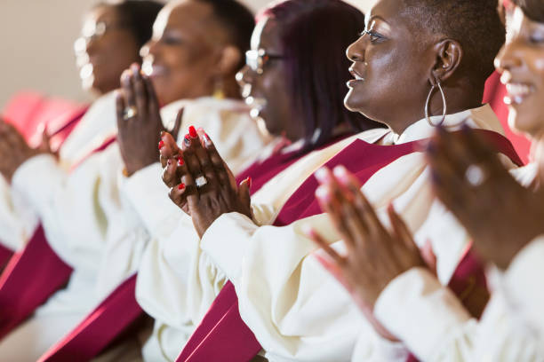 Group of mature black women in church robes stock photo