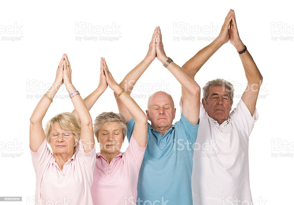 Group of mature people doing yoga royalty-free stock photo
