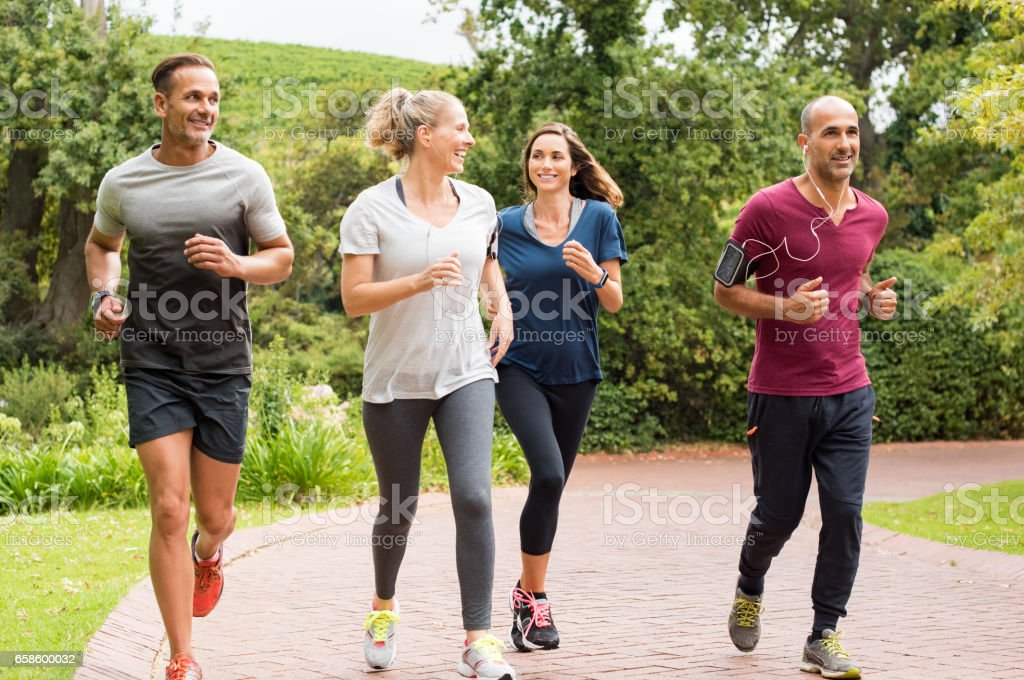 Group of mature people jogging royalty-free stock photo
