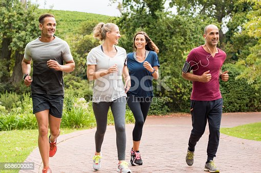istock Group of mature people jogging 658600032