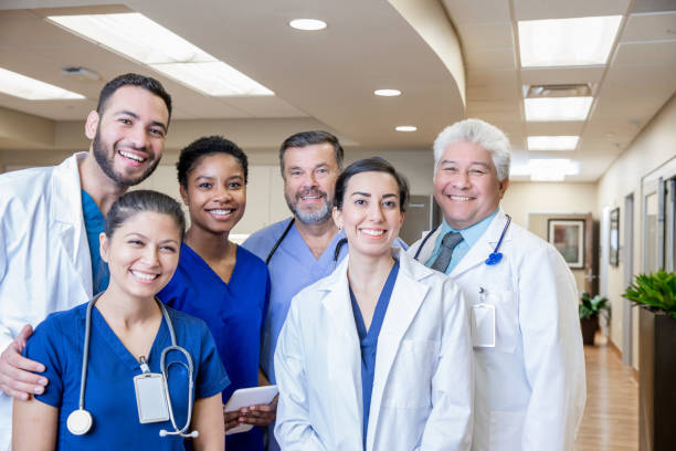 Group of medical professionals in hospital lobby stock photo