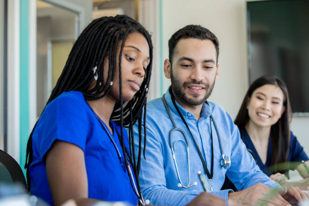 Group of medical professionals sitting at a conference table stock photo