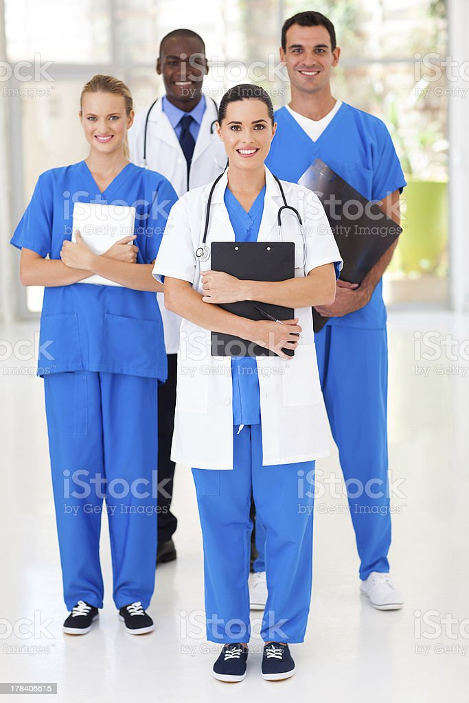 group of medical workers full length portrait stock photo