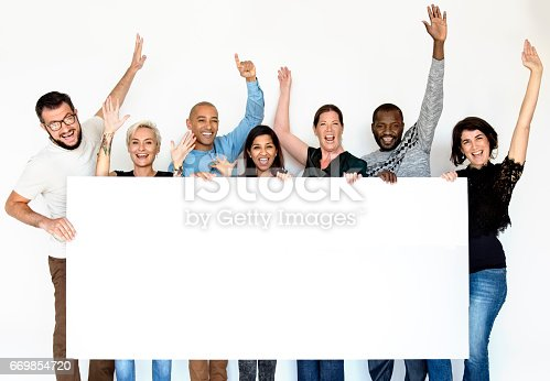 istock Group of Men and Female Show Present Blank Board 669854720