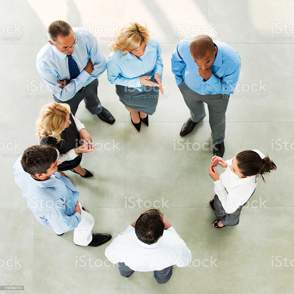 Group of men and women receiving instructions royalty-free stock photo