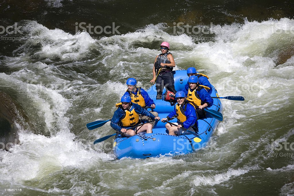 Group of Men and Women White Water Rafting royalty-free stock photo
