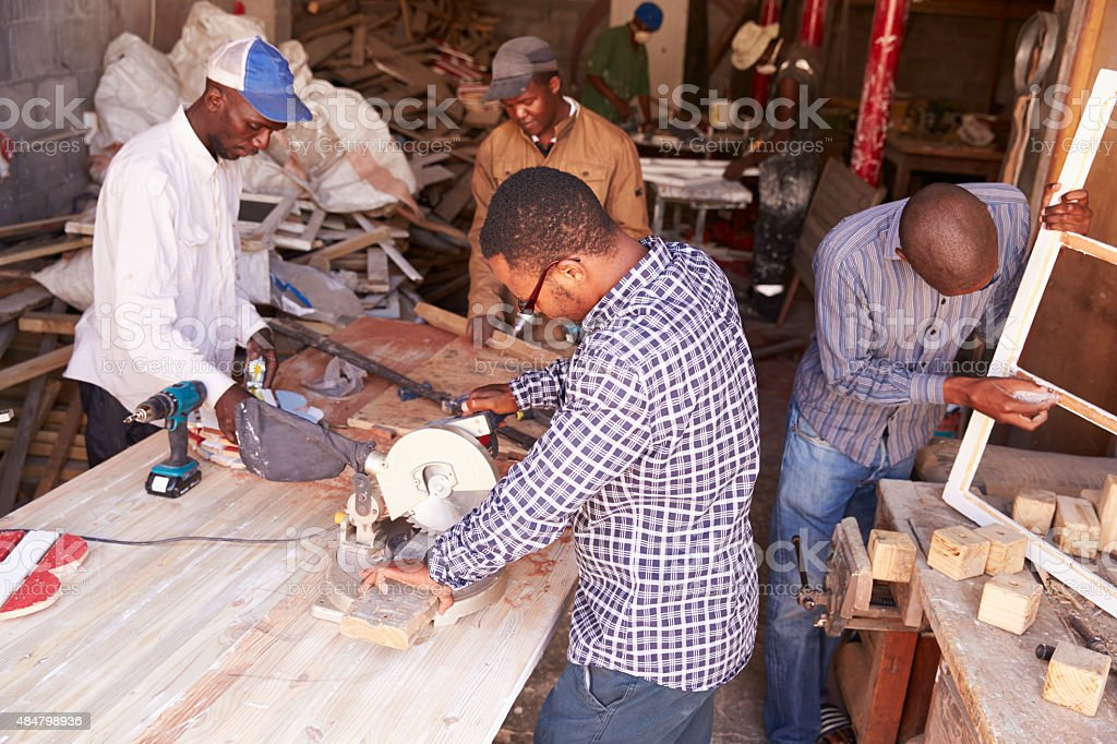 Group of men at work in carpentry workshop, South Africa stock photo