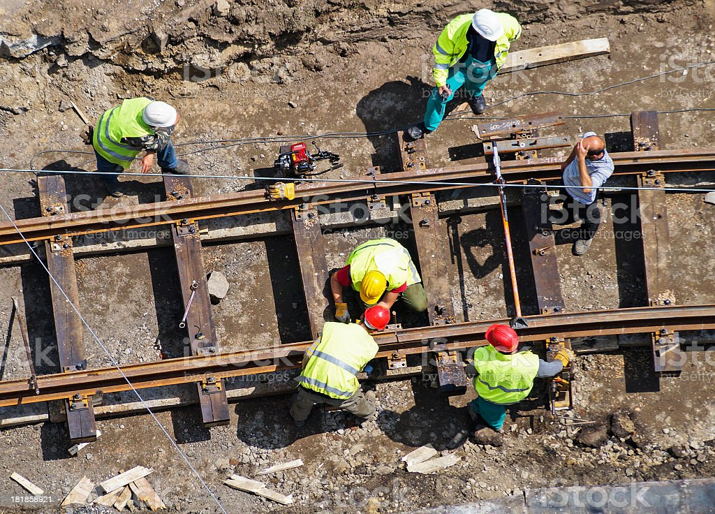 A group of men constructing a railway stock photo