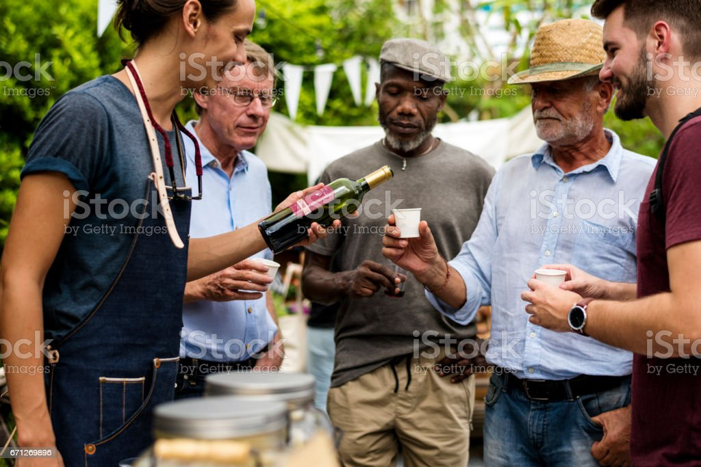 Group of men drinking local red wine together stock photo