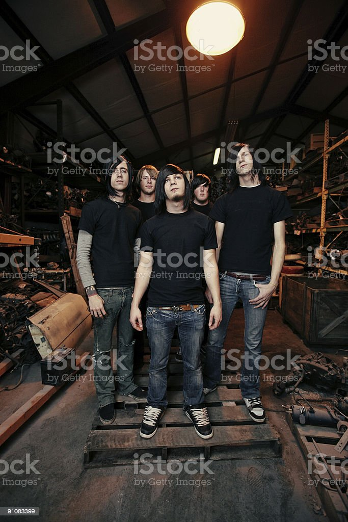 Group of Men in Old Workshop royalty-free stock photo