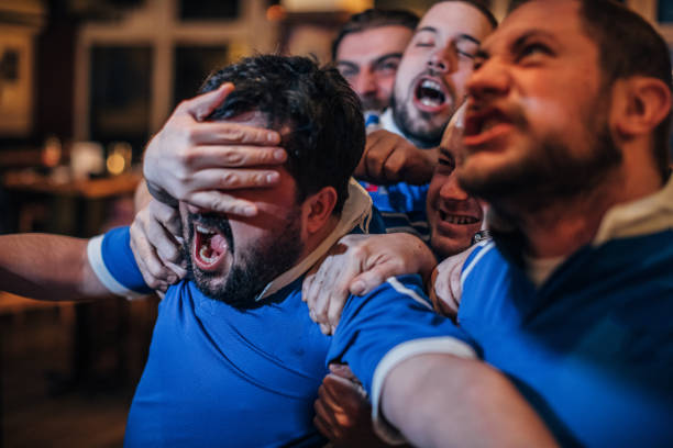 group of men in pub - aggression stock photos and pictures