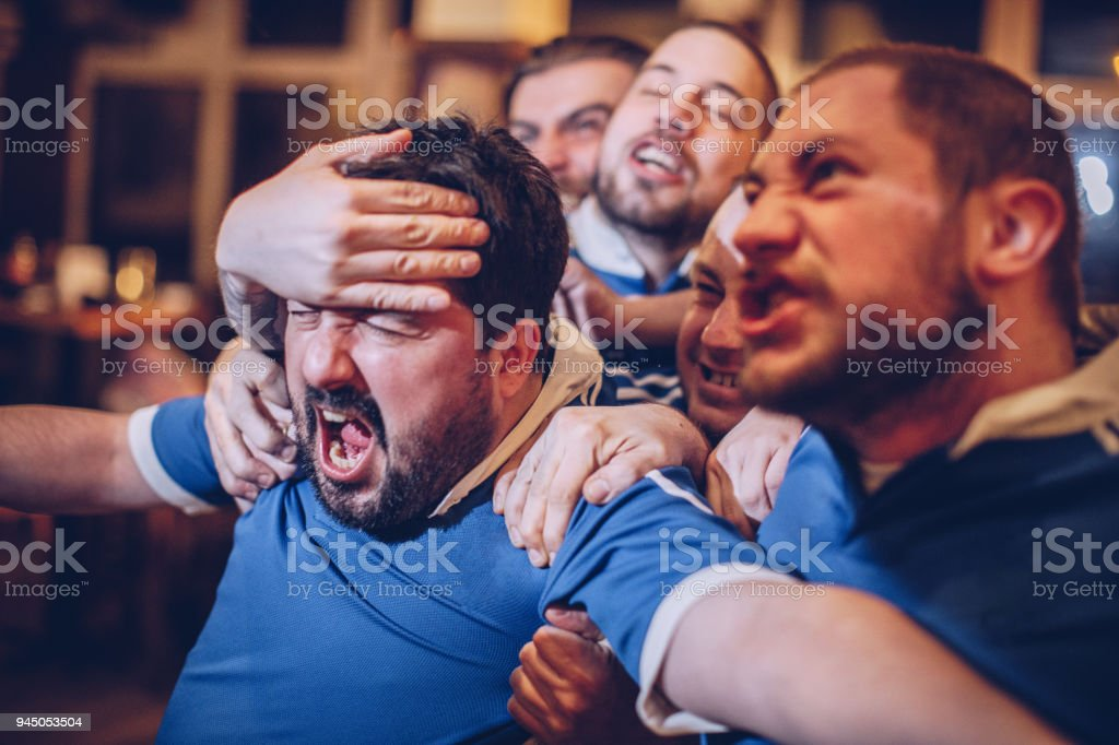 Group of men in sports pub stock photo