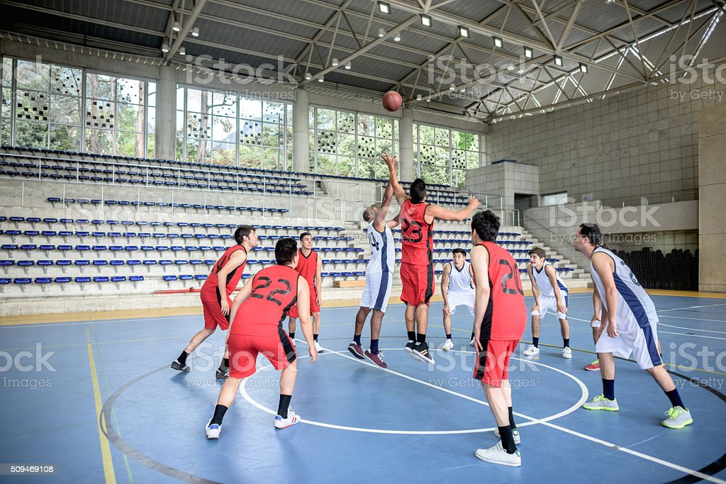 Group of men playing basketball stock photo