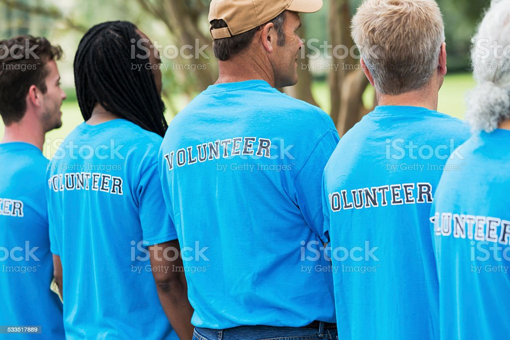 Group of men volunteering in a park stock photo