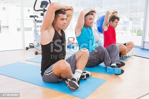 1069872470 istock photo Group of men working on exercise mat 474649082