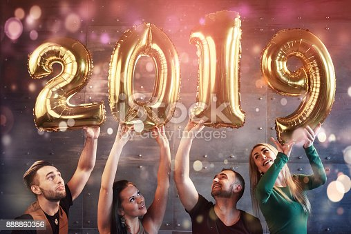 istock A group of merry young people hold numbers indicating the arrival of a new 2019 year. The party is dedicated to the celebration of the new year. Concepts about youth togetherness lifestyle 888860356