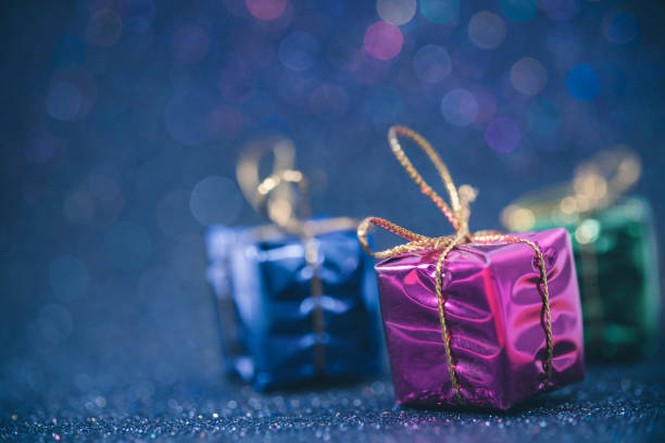 Group of metallic gift packs on blue background. Group of metallic gift packs on blue, glittery colorful bokeh background with huge copy space and shallow depth of field effect. happy birthday stock pictures, royalty-free photos & images