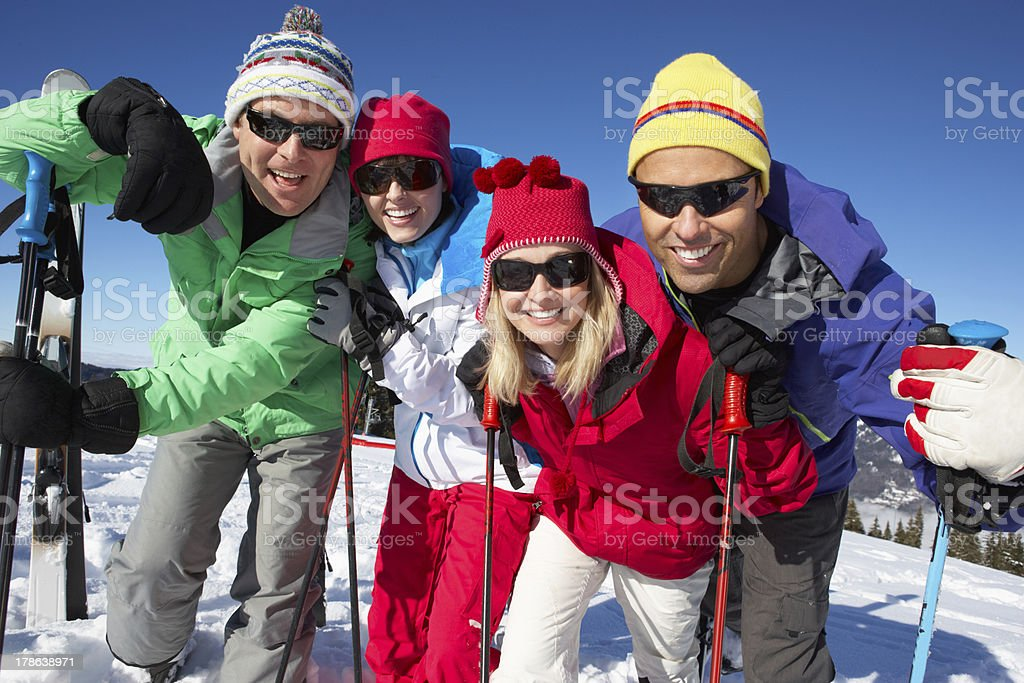 Group Of Middle Aged Couples On Ski Holiday In Mountains royalty-free stock photo