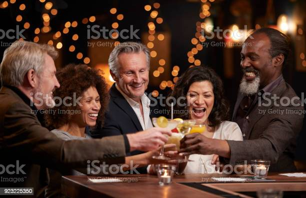 Group of middle aged friends celebrating in bar together picture id923225350?b=1&k=6&m=923225350&s=612x612&h=maxeuaty kzaxict4tapcooyrn mm gbngacompt3uo=