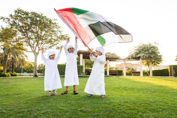 group of middle eastern kids in dubai - uae flag zdjęcia i obrazy z banku zdjęć