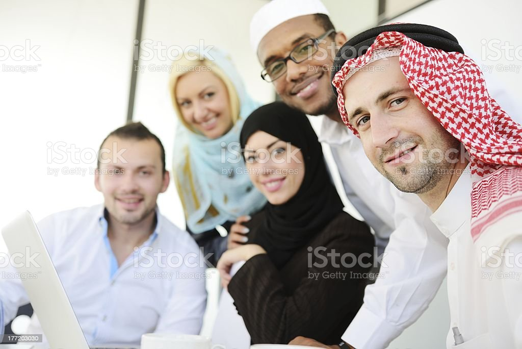 Group of middle eastern people looking into the camera stock photo