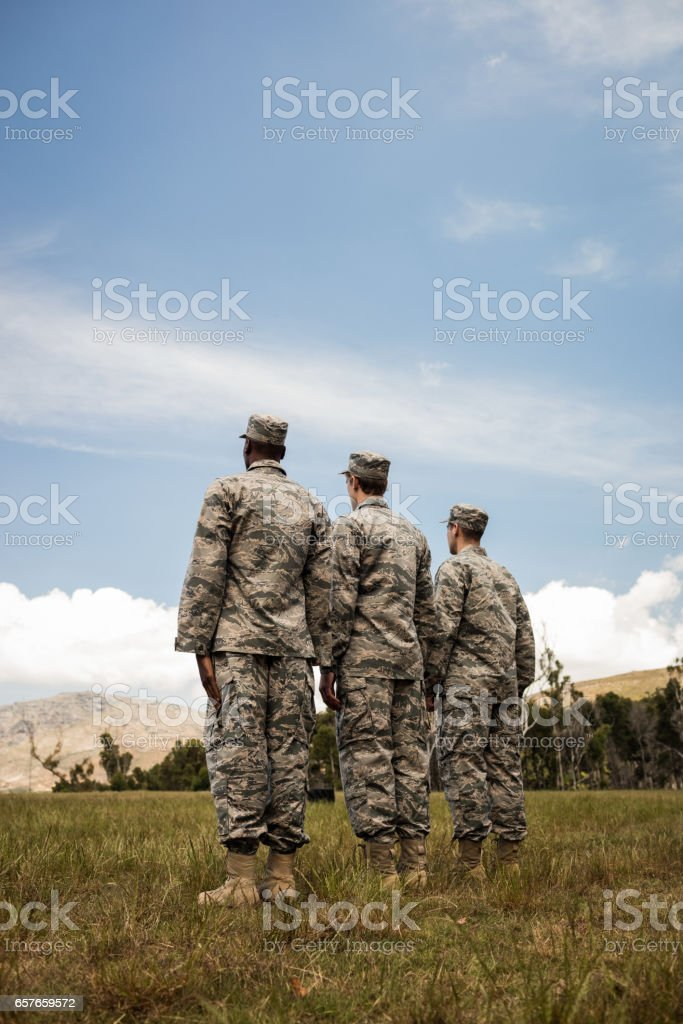 Group of military soldiers standing in line stock photo