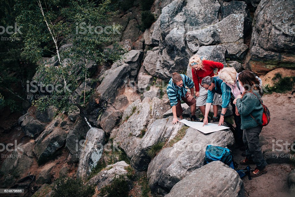 Group of mixed age people resting on hike stock photo