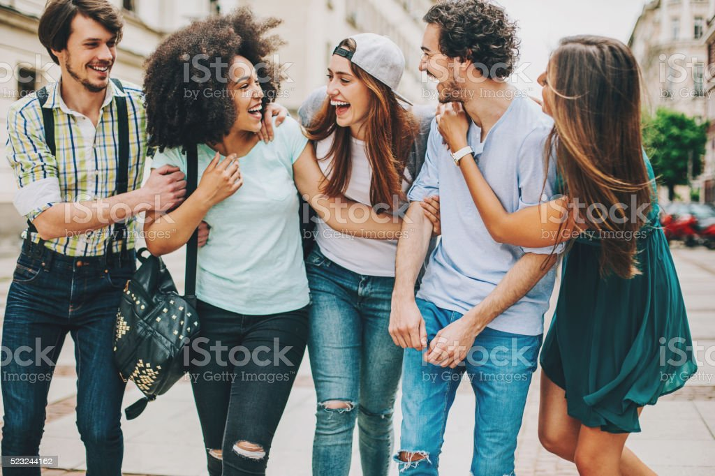 Group of mixed race friends outdoors stock photo