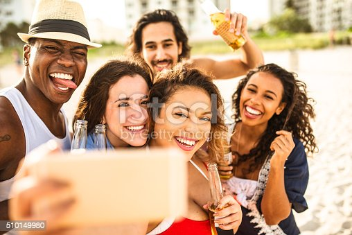 istock Group of mixed race friends take a selfie in miami 510149980