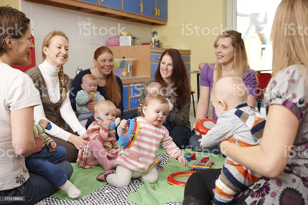 Group Of Mothers With Babies At Playgroup stock photo